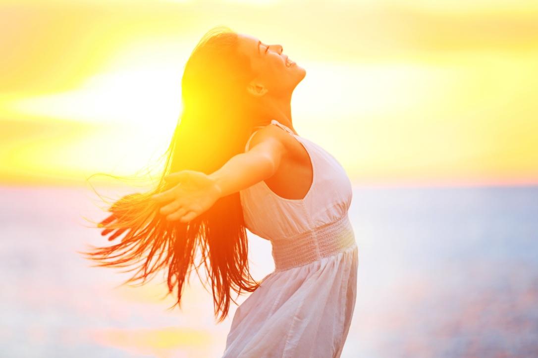 Enjoyment - free happy woman enjoying sunset